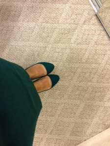green flats and green skirt